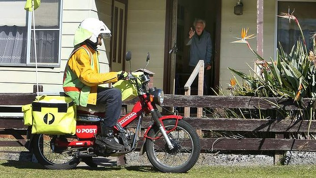 postie delivering mail to public